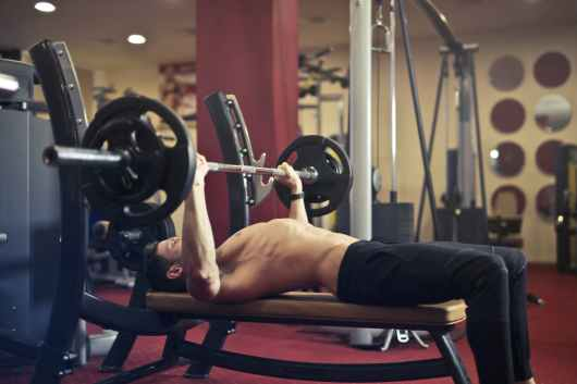 man doing bench press